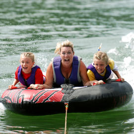 mom and daughters tubing on south lake tahoe