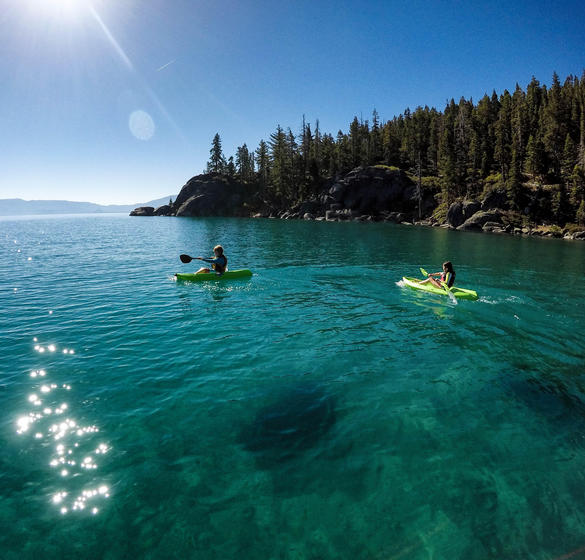 Two people canoeing on Lake Tahoe