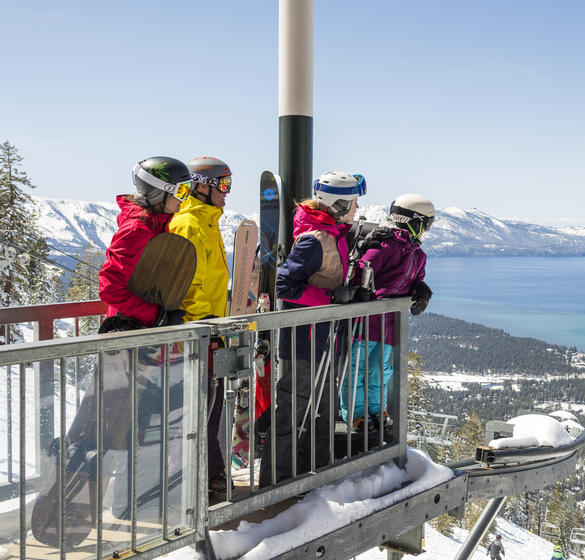 Four people overlooking lake tahoe